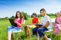 Kids drawing on clipboards together outside Royalty Free Stock Photography