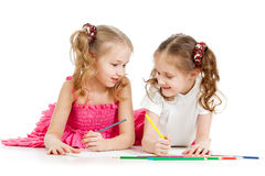 Kids drawing with color pencils together Royalty Free Stock Images