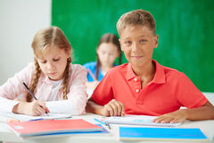 Kids at drawing lesson Royalty Free Stock Photos