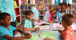 Kids drawing in library stock video footage