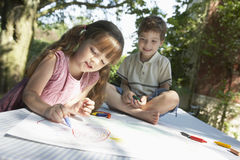 Kids Drawing On Outdoor Table Stock Photos