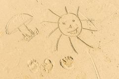Kids drawings on the beach sand. Kids hand drawings on the beach sand Stock Photography