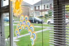 Free Kids Drawings Of Rainbows In A Window During Covid-19 Lockdown In Uk Royalty Free Stock Photography - 181021927