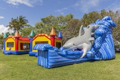 Kids dream of a bounce house party at the park stock photo