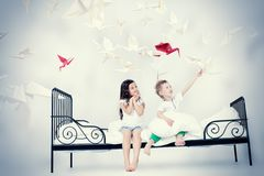 Kids dream. Cute kids sitting together on the bed under the blanket. Dream world Stock Photo