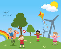 Kids Dreaming a Green World. Four cute kids playing in a green world in a spring day with wind turbines, trees and rainbow. Useful for educational and learning Royalty Free Stock Photo
