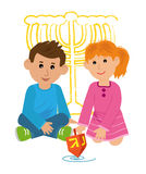 Kids With Dreidel. Boy and a girl are playing with dreidel. Eps10 Stock Photography