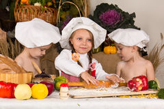 Kids dressed as chefs cooking Stock Images