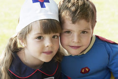 Kids Dressed As Nurse And Superhero Stock Photos