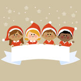 Kids dressed in Christmas costumes holding horizontal blank banner. A happy multicultural group of children dressed in Christmas costumes holding a blank Royalty Free Stock Image