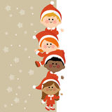 Kids dressed in Christmas costumes holding vertical blank banner Royalty Free Stock Image