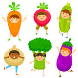 Kids dressed like vegetable Stock Images