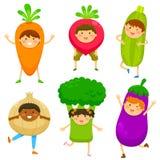 Kids dressed like vegetable Stock Images