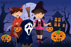 Kids dressed up in costumes trick or treating. A vector illustration of kids dressed up in costumes trick or treating during Halloween Royalty Free Stock Photos