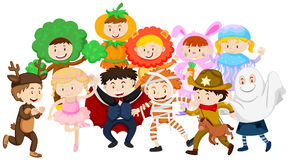 Kids dressing up in different costumes Stock Images