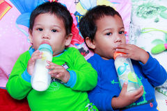Kids drink bottled formula milk Stock Images