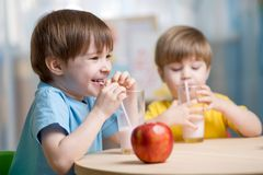 Kids drinking milk at home. At home or kindergarten Stock Photography