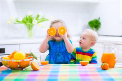Kids drinking orange juice Stock Photo