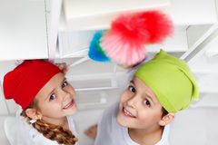Kids dusting in their room Royalty Free Stock Photos