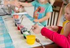 Peoria, IL/USA - 03-31-2018: Kids dyeing Easter eggs royalty free stock image