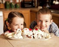 Kids eager for ice cream. Two kids eagerly waiting to eat ice cream Royalty Free Stock Photography