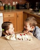 Kids eager for ice cream. Two kids eagerly waiting to eat ice cream Royalty Free Stock Photos