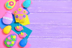 Kids Easter background. Handmade colorful felt Easter crafts on lilac wooden background with empty copy space for text Stock Images