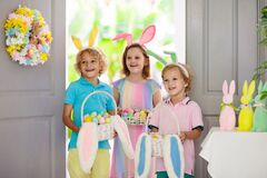 Kids Easter egg hunt. Child and eggs, bunny ears