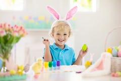 Kids on Easter egg hunt. Children dye eggs stock images