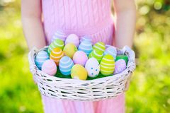 Kids on Easter egg hunt with eggs basket. Easter egg hunt. Little girl with eggs basket. Kids searching for sweets and chocolate on Easter morning in garden Stock Image