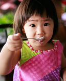 Kids eat breakfast royalty free stock photos