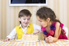 Kids eat cake Royalty Free Stock Photo