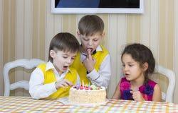 Kids eat cake Stock Photo
