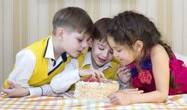 Kids eat cake Stock Images