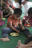 KIDS EAT RICE CELEBRATION DAY PRESS Royalty Free Stock Photo