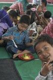 KIDS EAT RICE CELEBRATION DAY PRESS Royalty Free Stock Image