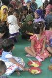 KIDS EAT RICE CELEBRATION DAY PRESS Royalty Free Stock Images
