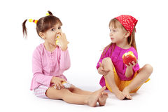 Kids eating apples. Portrait of cute kids eating apples over white stock photos