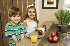 Kids eating breakfast. stock photo
