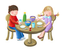 Kids eating breakfast Stock Photography