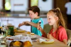 Kids eating breakfast Royalty Free Stock Photo