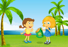 Kids eating chips at the river Royalty Free Stock Images
