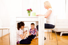 Kids eating chocolate at home Stock Photography