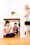 Kids eating chocolate at home Stock Image