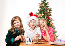 Kids eating  cookies Royalty Free Stock Photography