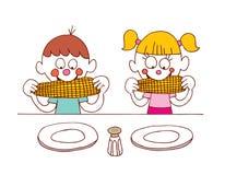 Kids eating corn Stock Photo