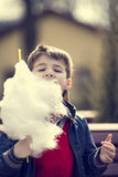 Kids eating cotton candy Stock Image