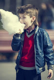 Kids eating cotton candy Royalty Free Stock Image