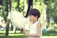 Kids eating cotton candy Stock Photo