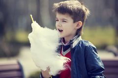 Kids eating cotton candy Stock Photos